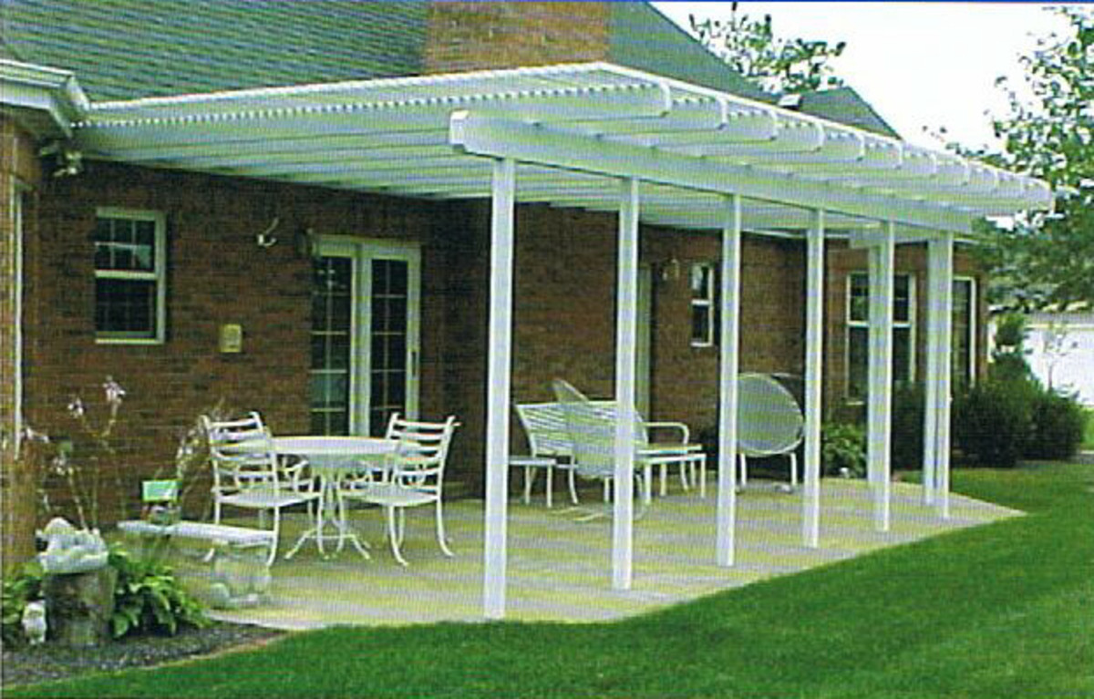 pergola over a cement patio