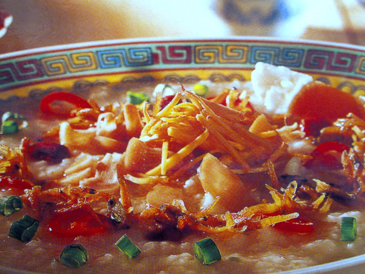 Garnish of crispy fried onions and ginger on hot porridge