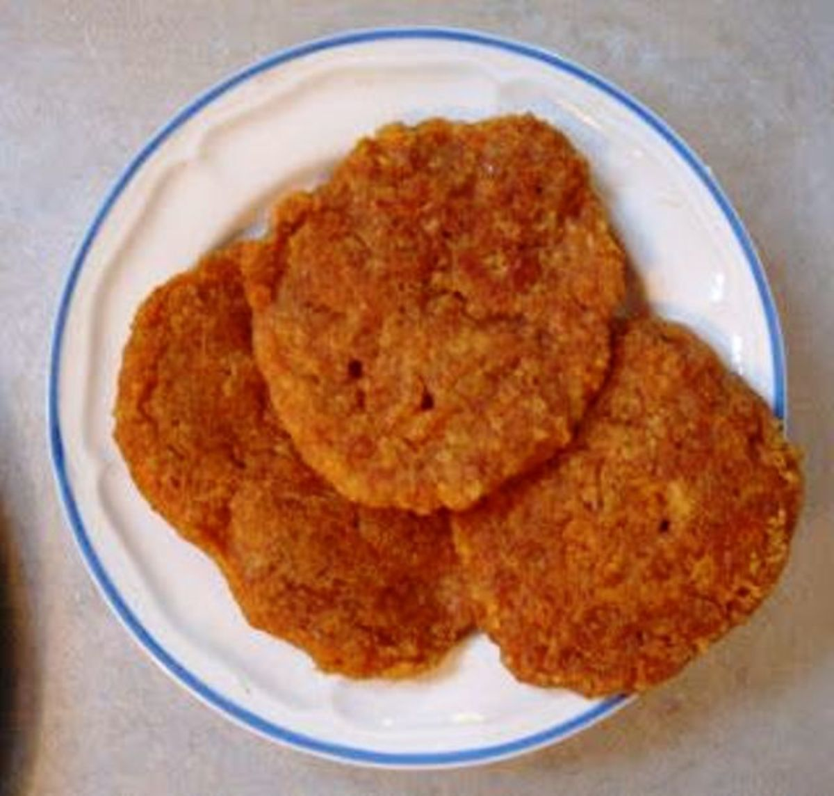 Millet or Quinoa Patties are generally served with a vegetarian gravy in a cake pan.  They are generally a hit
