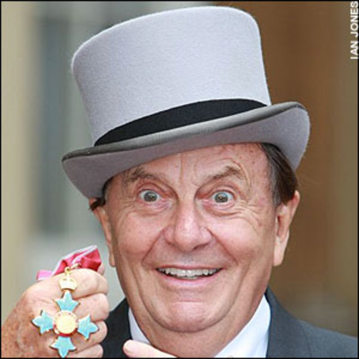 Dame Edna's alter-ego Barry Humphries, looking strangely like the Mad Hatter