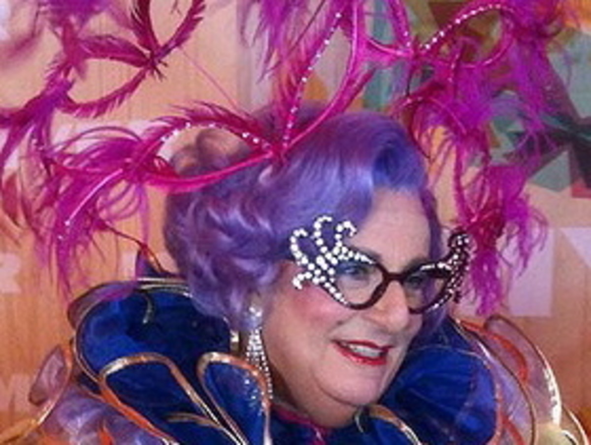 Dame Edna in a frivolous pink concoction