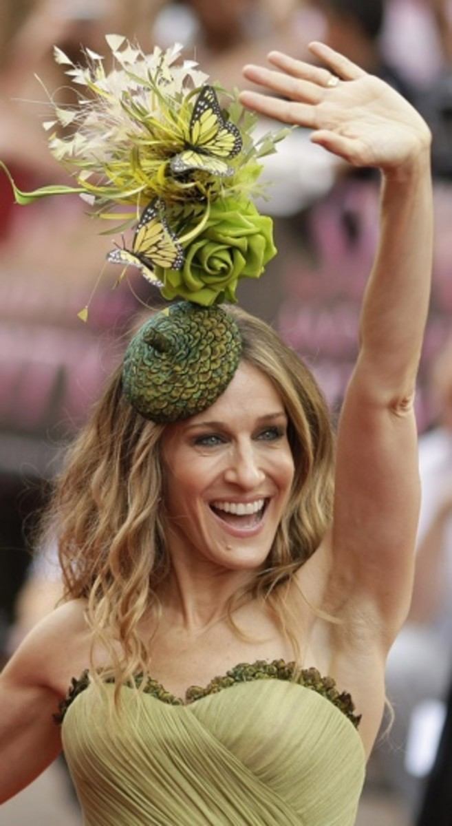 Sarah Jessica Parker waves to get attention, just in case no-one noticed her crazy olive green floral hat
