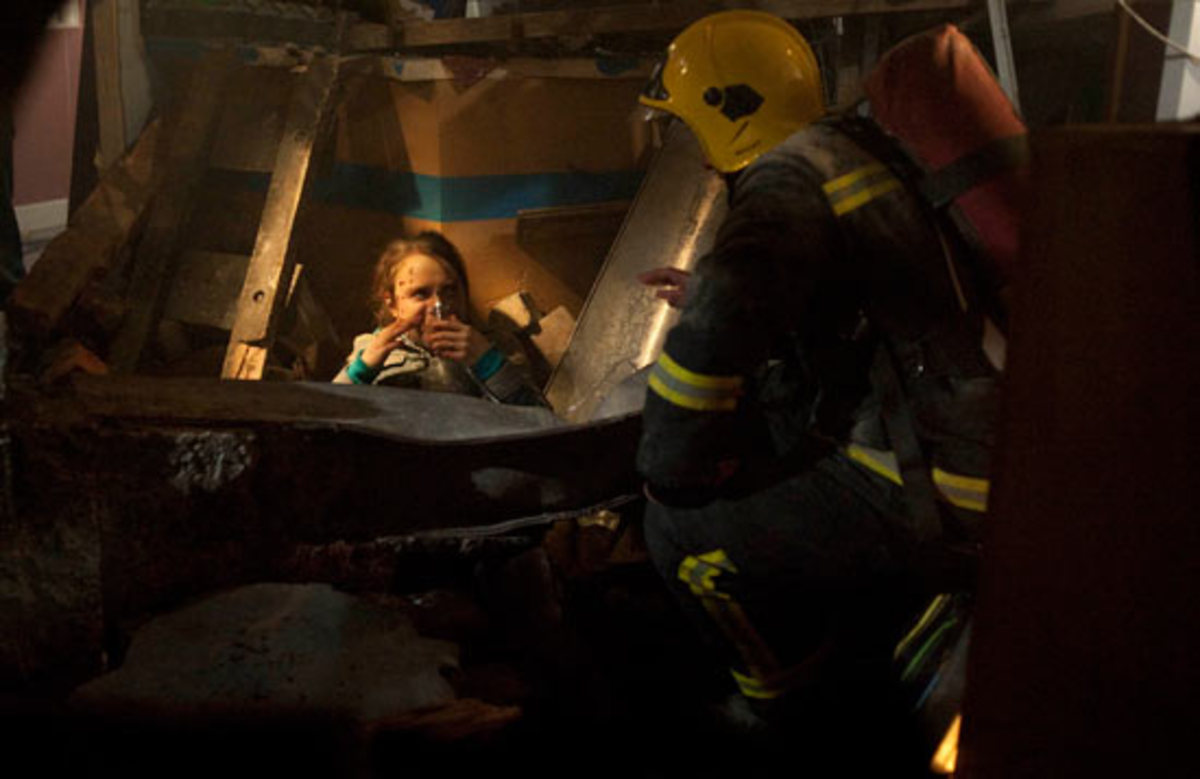 Fire fighters have saved baby Jack from the rubble and are fighting to to get his Mum Molly out