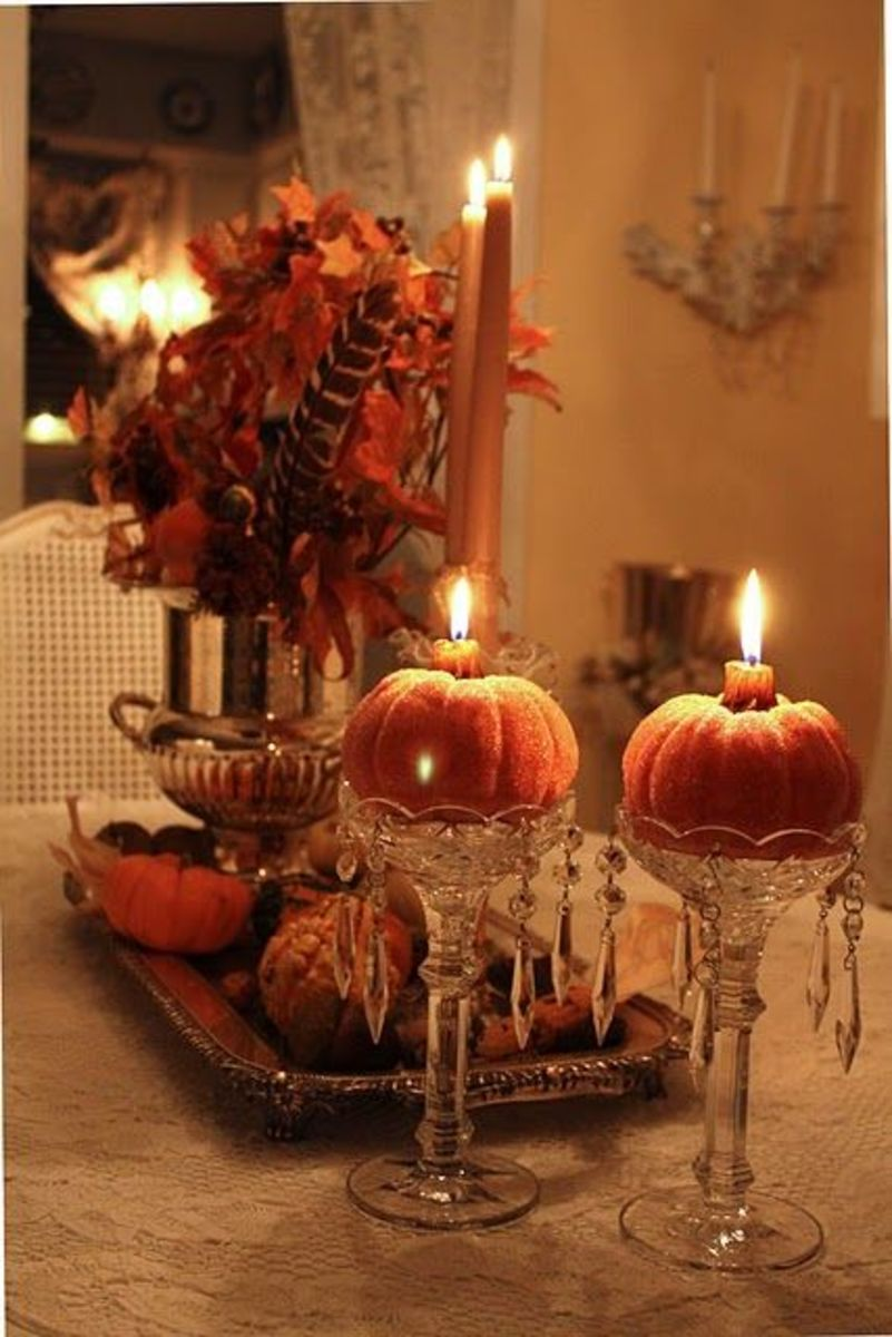 Use pumpkins and gourds as candle holders.