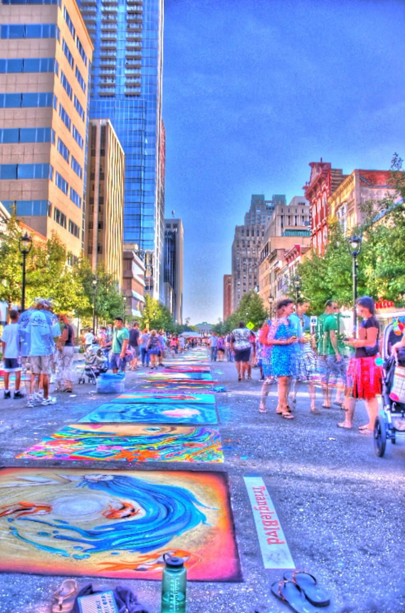 An photo of the 2010 SparkCon Festival in Raleigh, NC which featured Sidewalk Chalk Murals.