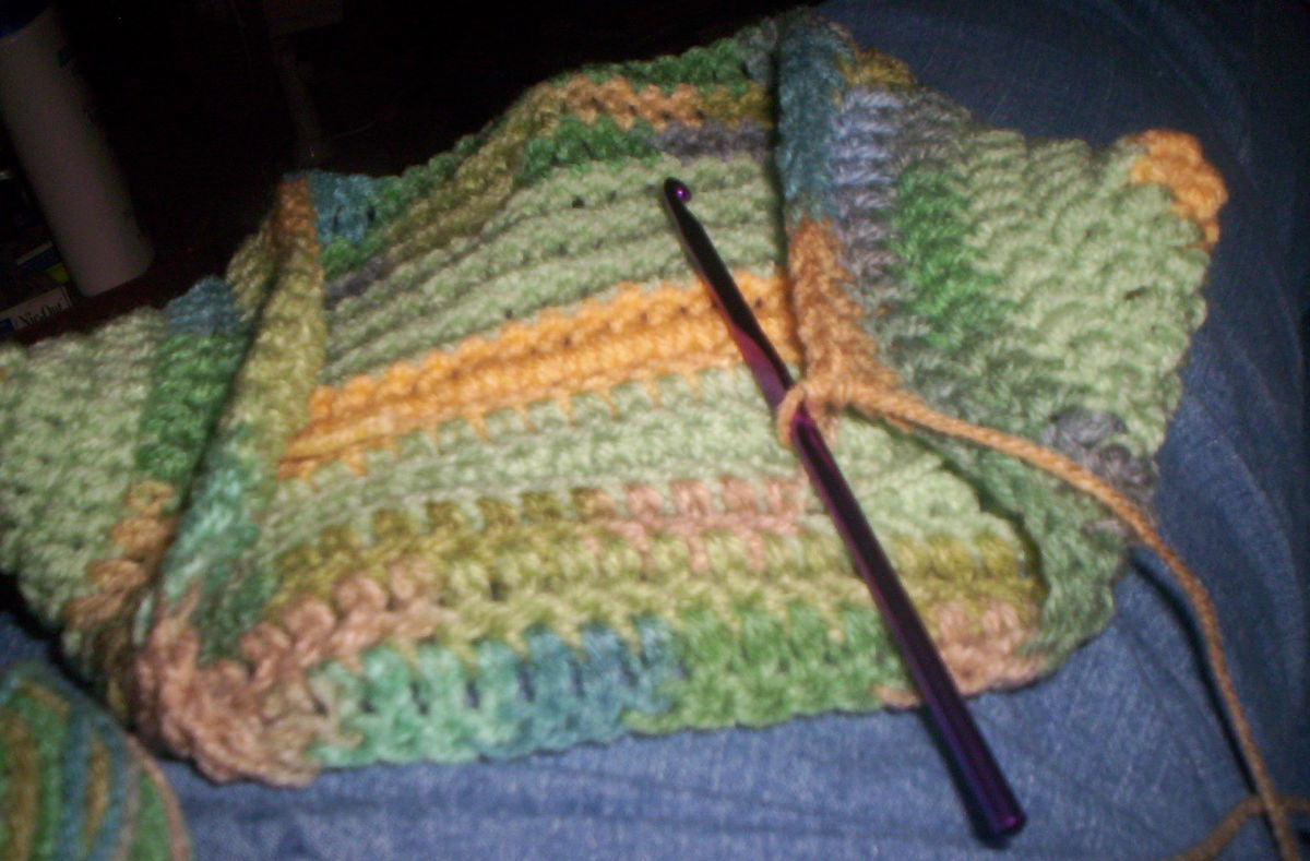 Your potholder is starting to take shape after several more rounds of stitches.