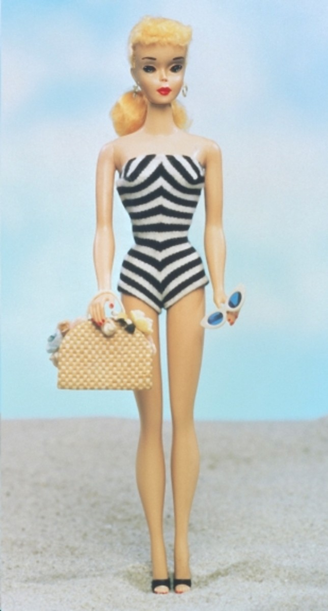 1959-The first Barbie Doll, complete with accessories