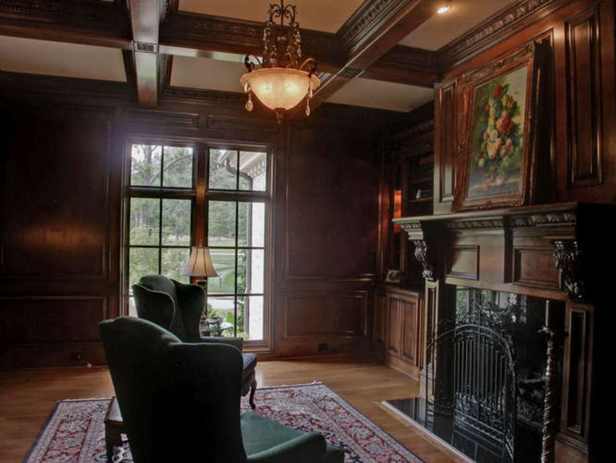 vintage woodwork with extensive carving in library type family room