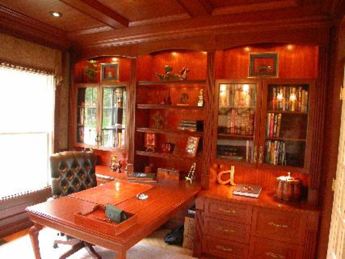 lighted cabinets with book shelves in rich woodwork