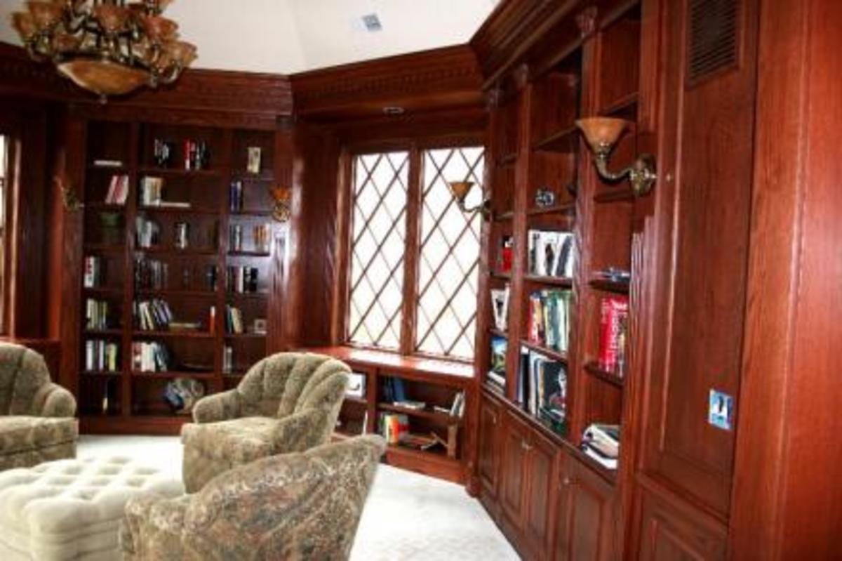 leaded glass windows with deep warm woodwork in iibrary