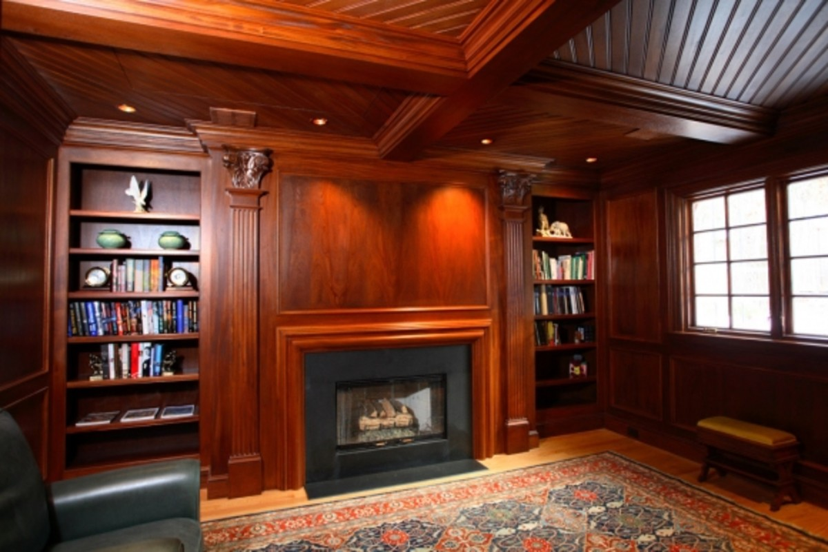 classic fireplace surrounded by book shelves on either side of hearth