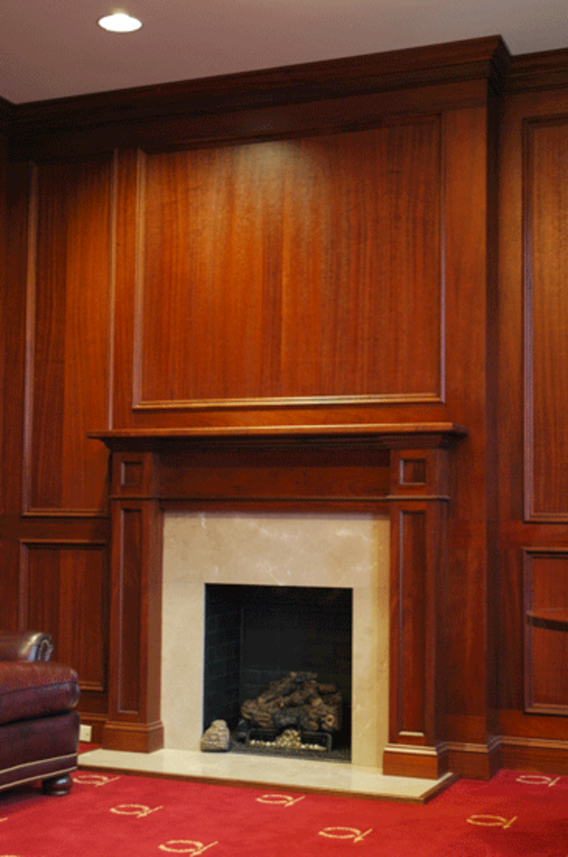 classic wood fireplace and beautiful wood surround