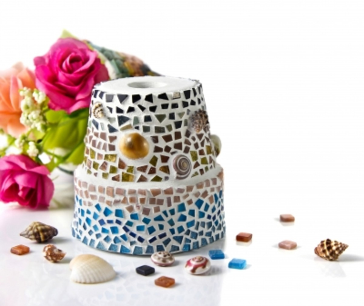 Children love to decorate flower pots.  Inexpensive, variety of sizes and choices of glass.  Available at craft stores everywhere. Grandmas love this gift.