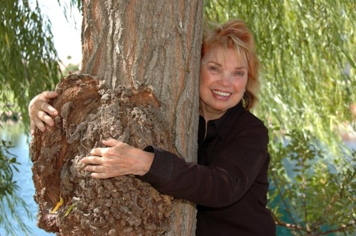 "Author Audrey Hunt getting her tree fix. ""When I touch a tree I feel the hand of my creator."""