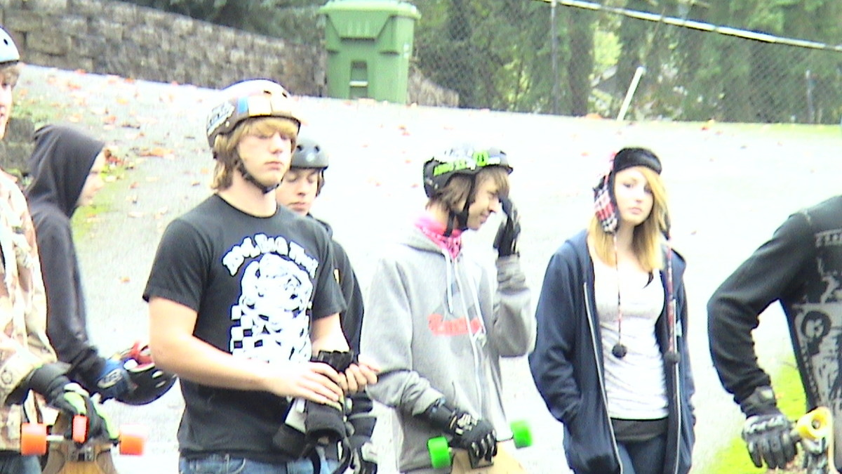 Extreme Long Board Skating Competition on Wet Slope
