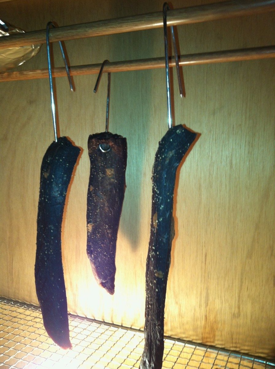 Sour plum biltong on day 4. These strips of biltong are ready to eat. They have hung in the drying box for 3 and a half days. In this picture the light is on, but that is only for the picture. I actually turned the light off toward the end of day 2.