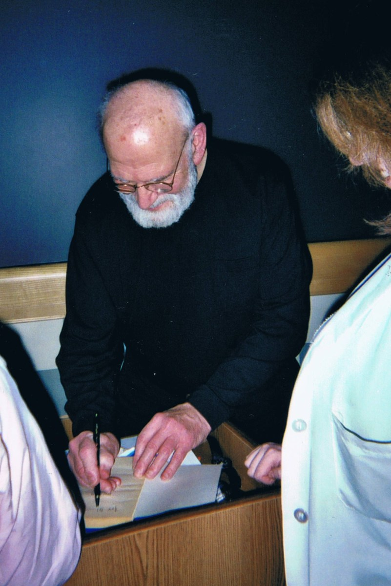 Here is a photo I took of Dr. Sacks signing for an intern. Below, one with me and Dr. Sacks.