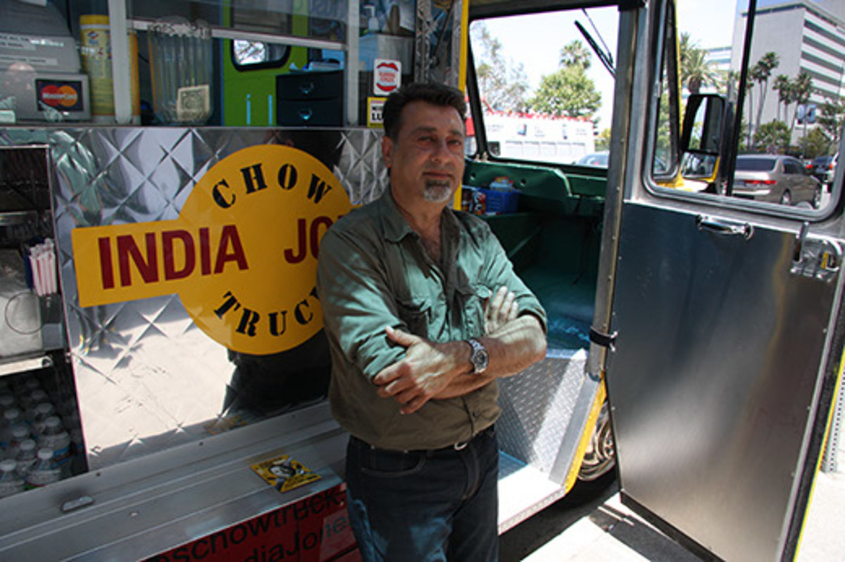 Sumant Pardal can be found sitting at a small, folding wooden table outside the India Jones Chow Truck, hanging out with his customers and watching them enjoy his amazing Indian street food.
