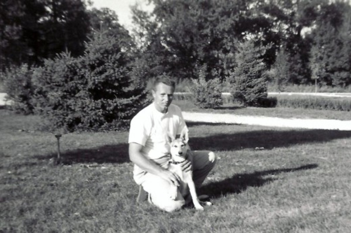 My dad and our dog Sheba as a puppy