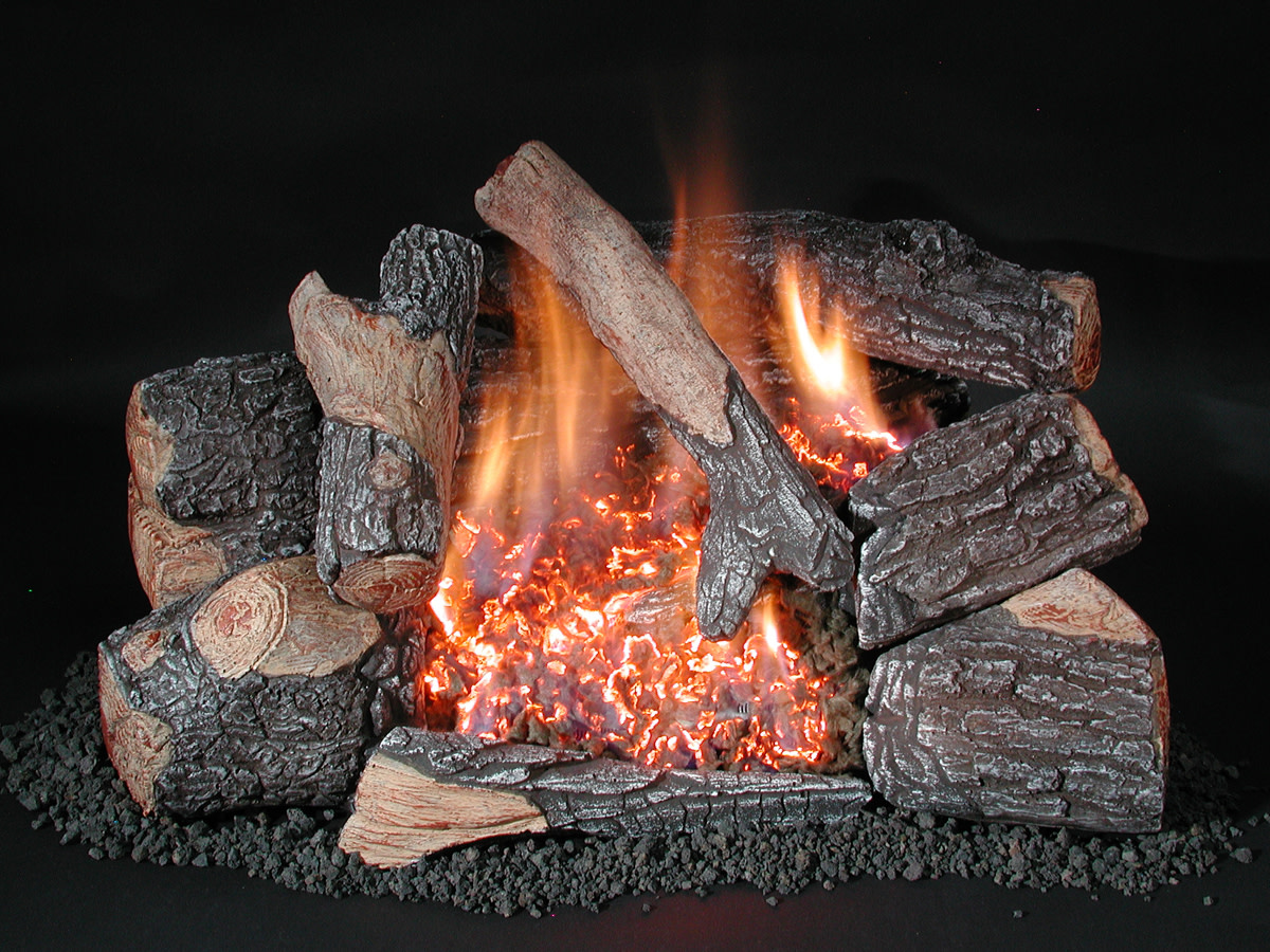 This is a ventless gas fireplace double burner.  The visual difference is huge!  Note the glowing embers that mark the second burner moving diagonally.  Flames are not as tall as a single burner but there is more flame and light.