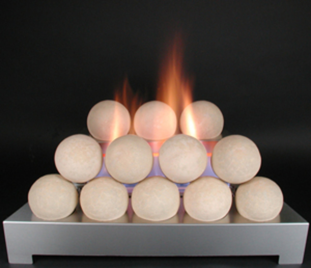 beige fireballs on a stainless steel burner in a ventless gas fireplace.