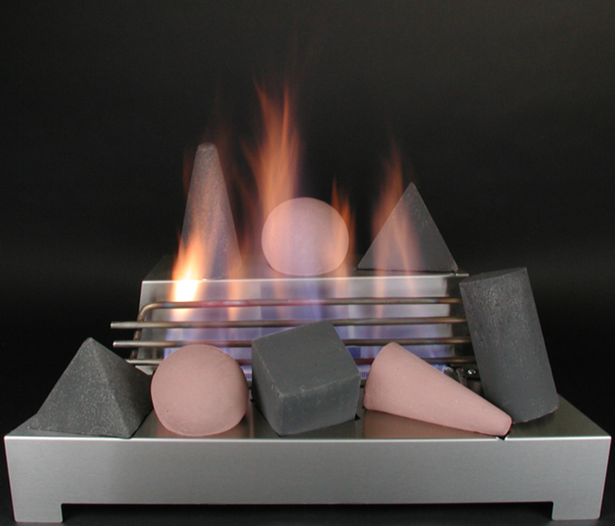 stainless steel ventless gas fireplace burner with fire shapes burning.