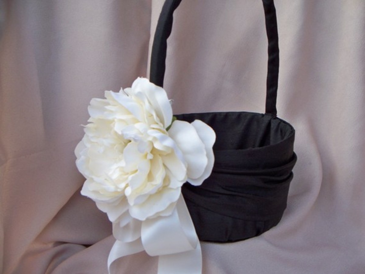 Classic flower girl basket for an elegant evening wedding