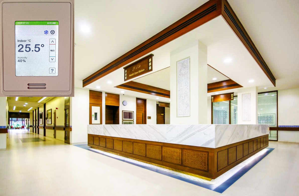 Thermostat's location relative to AC supply and return outlets is critical to maintaining temperatures within the specified range in indoor spaces. Inset shows a digital temperature controller used in this building.