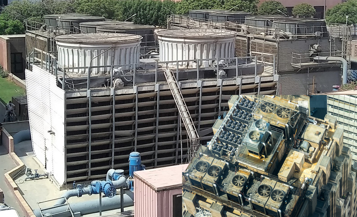 These large cooling towers have reduced efficiency due to increased heat island effect, owing to their proximity to ground level and lack of incident wind. Inset shows cooling towers on top of a high rise building, those will be more efficient.