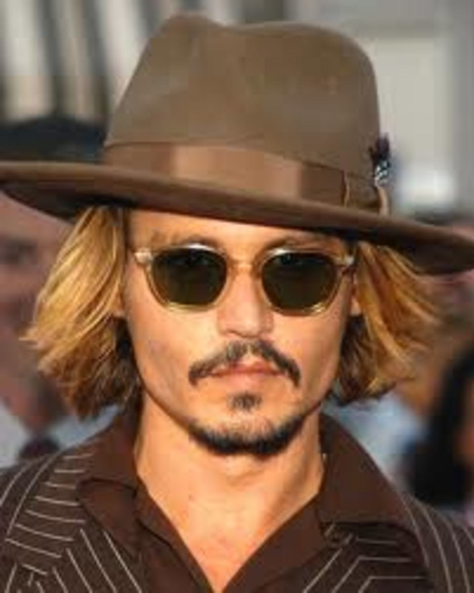Johnny Depp in a hat looks just like Gary Oldman.