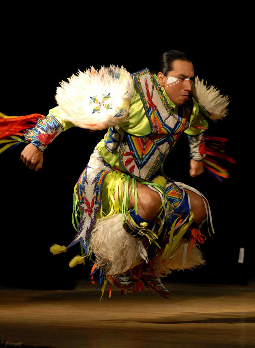Larry Yazzie, with Native Pride Productions, entertains guests through tribal dance at Joint Base-Myer Henderson Hall in celebration of Native American Heritage Month. 11/20/09 The dancer is wearing regalia of the American Southwest.