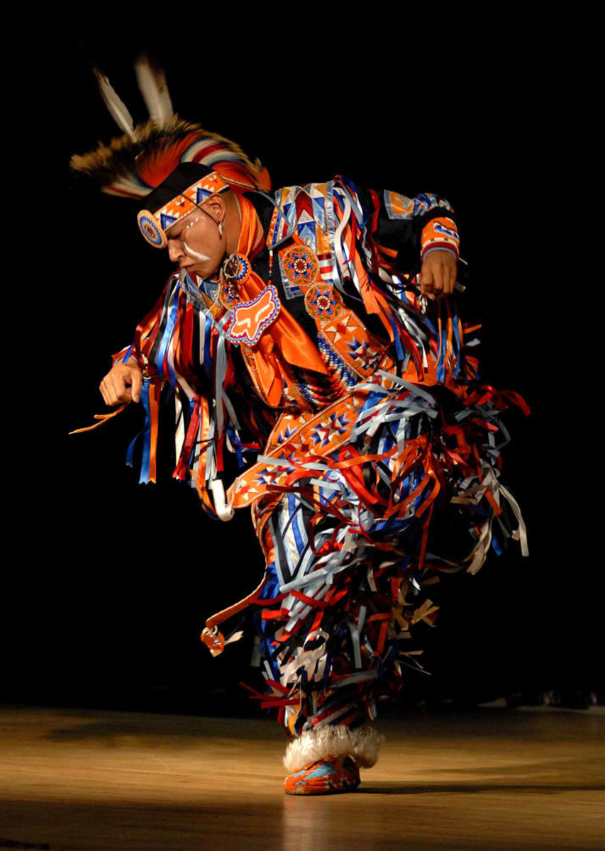 Arlen Whitebreast, with Native Pride Productions, performs a tribal dance to entertain guests at Joint Base-Myer Henderson Hall in celebration of Native American Indian Heritage Month. 11/20/2009