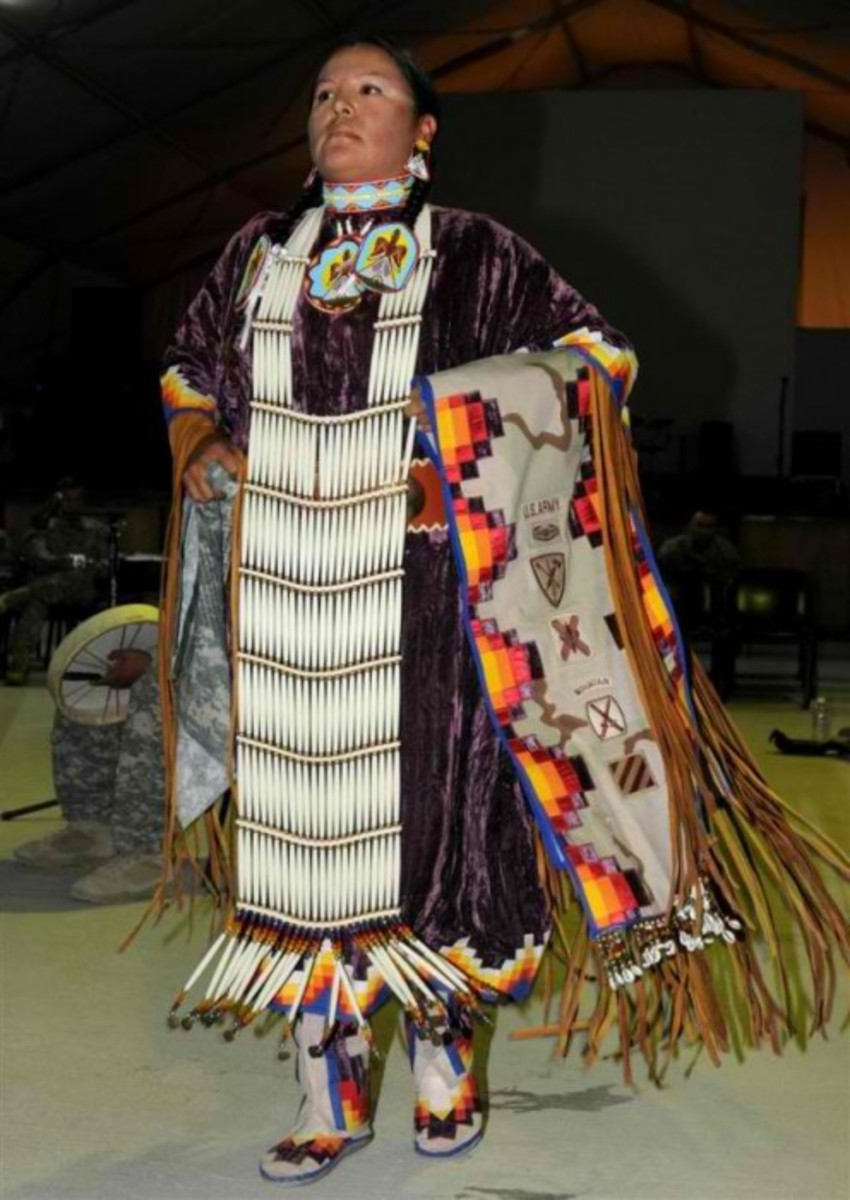 Sgt. Mary Ann Bullhead-Chavez, a military police officer with the 720th Convoy Support Battalion out of Albuquerque, N.M., performs a women's northern traditional dance which originated from the Native American Plains tribe at an annual festival.