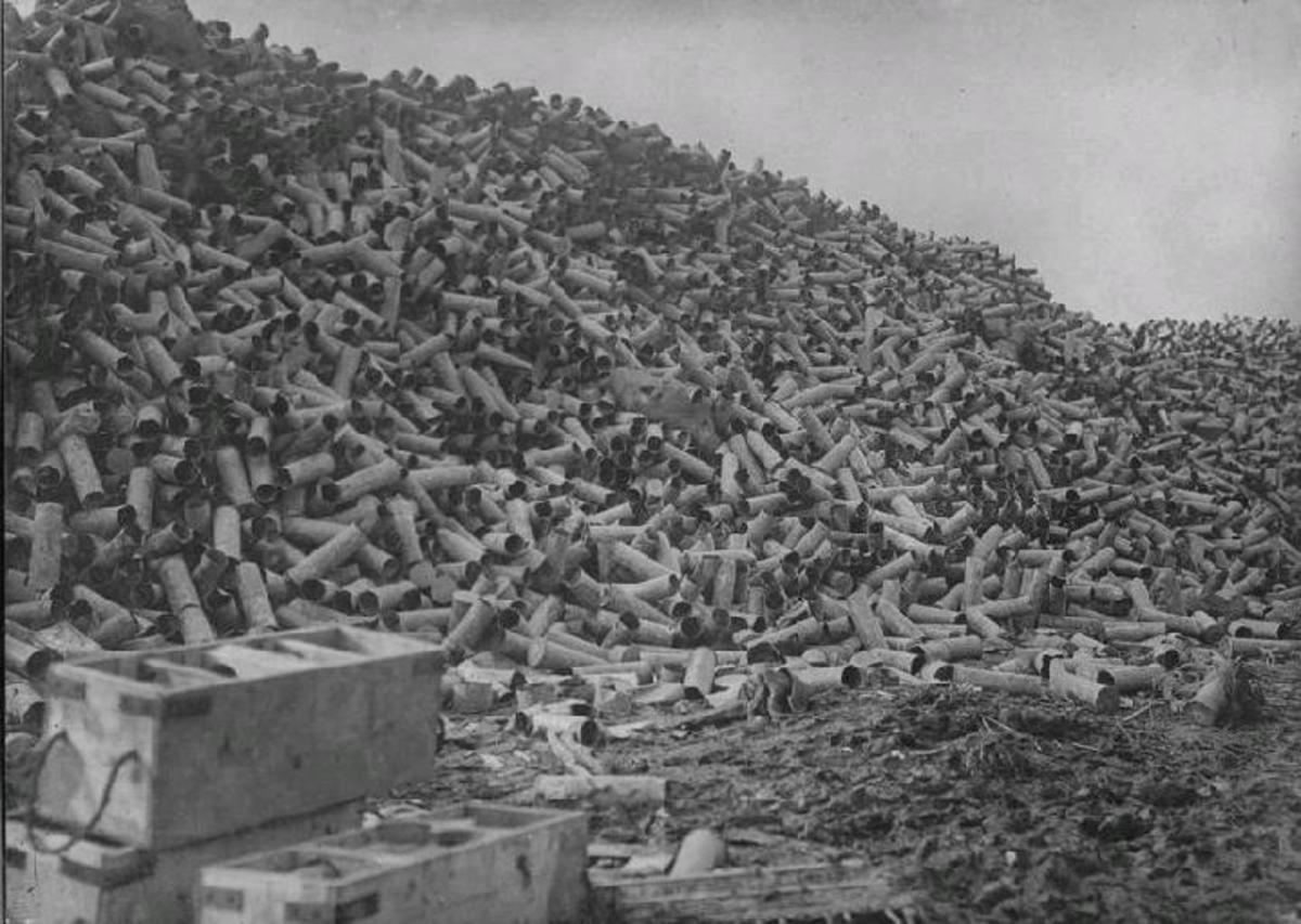 One week of shelling created this pile of shell cases.  If the average artillery shell took one life, then how many lives were taken here?