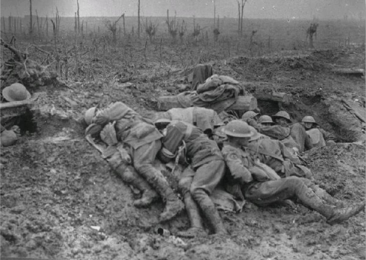 This photo shows if nothing else a soldier curled up clasping his ears in an attempt to take the noise away... usually only death could do that.