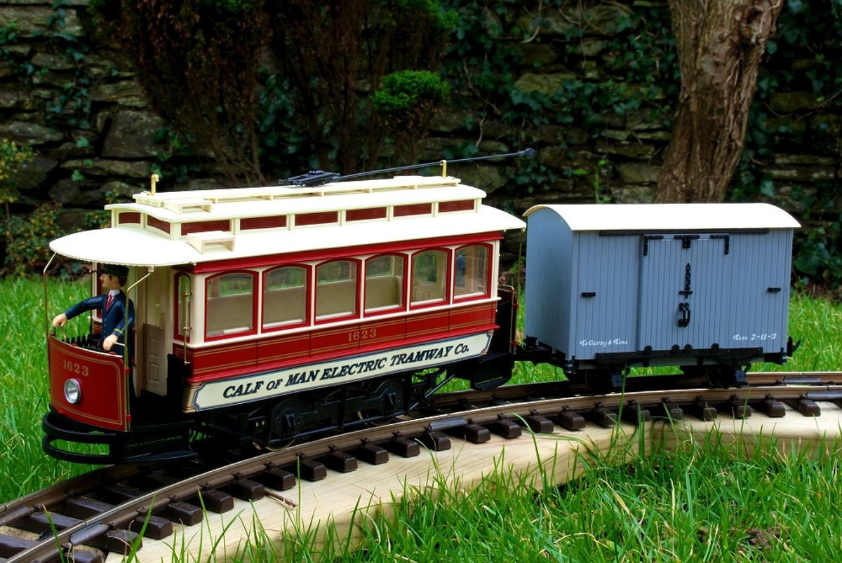Bachmann Street Car as freelance line Calf of Man Electric Tramway (or COMET) and van on my Tempoary Garden Railway -   David Lloyd-Jones 2010