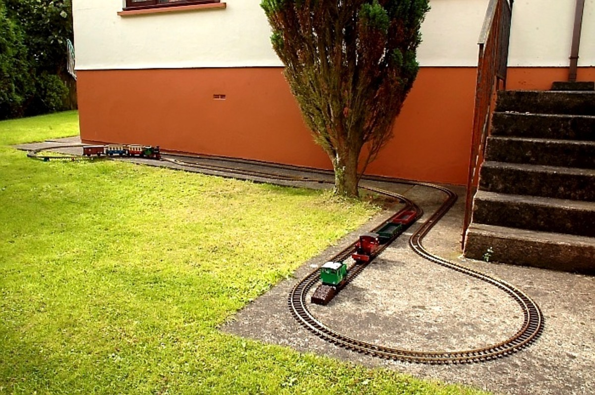 While only small, and limited operationally, a Temporary Garden Railroad can provide enough to maintain interest until a more permeant one be built -   David Lloyd-Jones 2010
