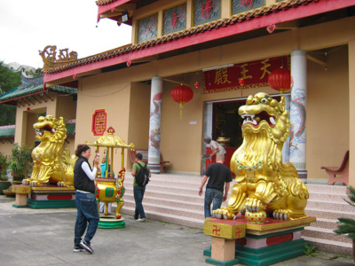 Golden lions sit majestically at the front of the temple.