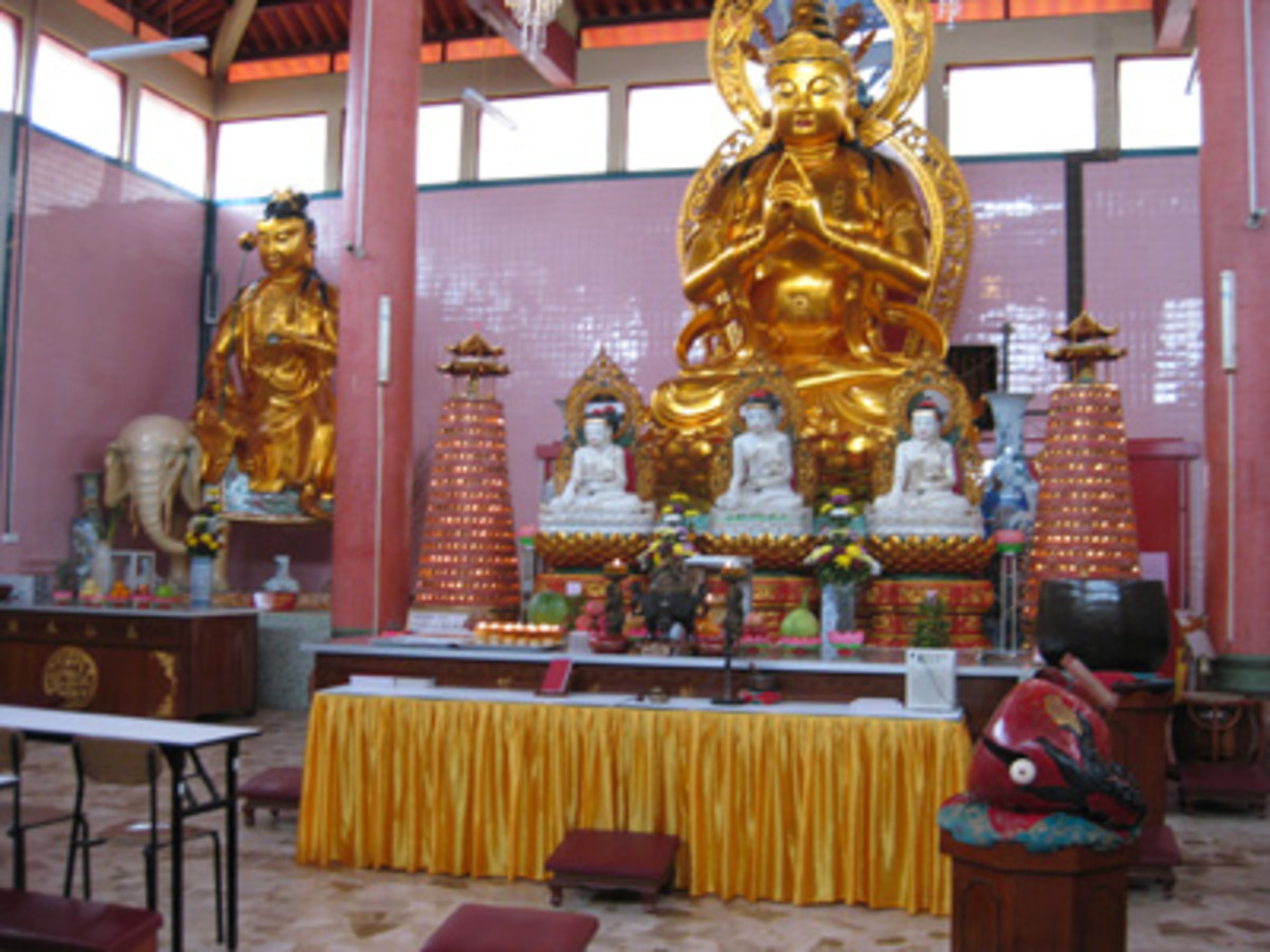 Inside the temple, offerings of fruit and flowers are placed on alters to please Buddha and bring good fortune.