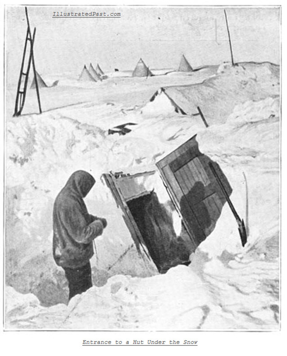 Entrance to an underground hut carved into the snow.