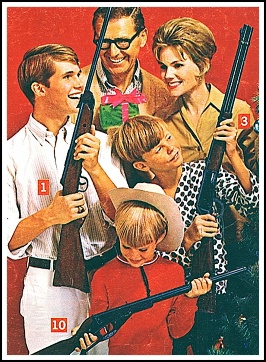 It's a great Christmas when the whole family gets a gun!  Wait! Where's Mom's??