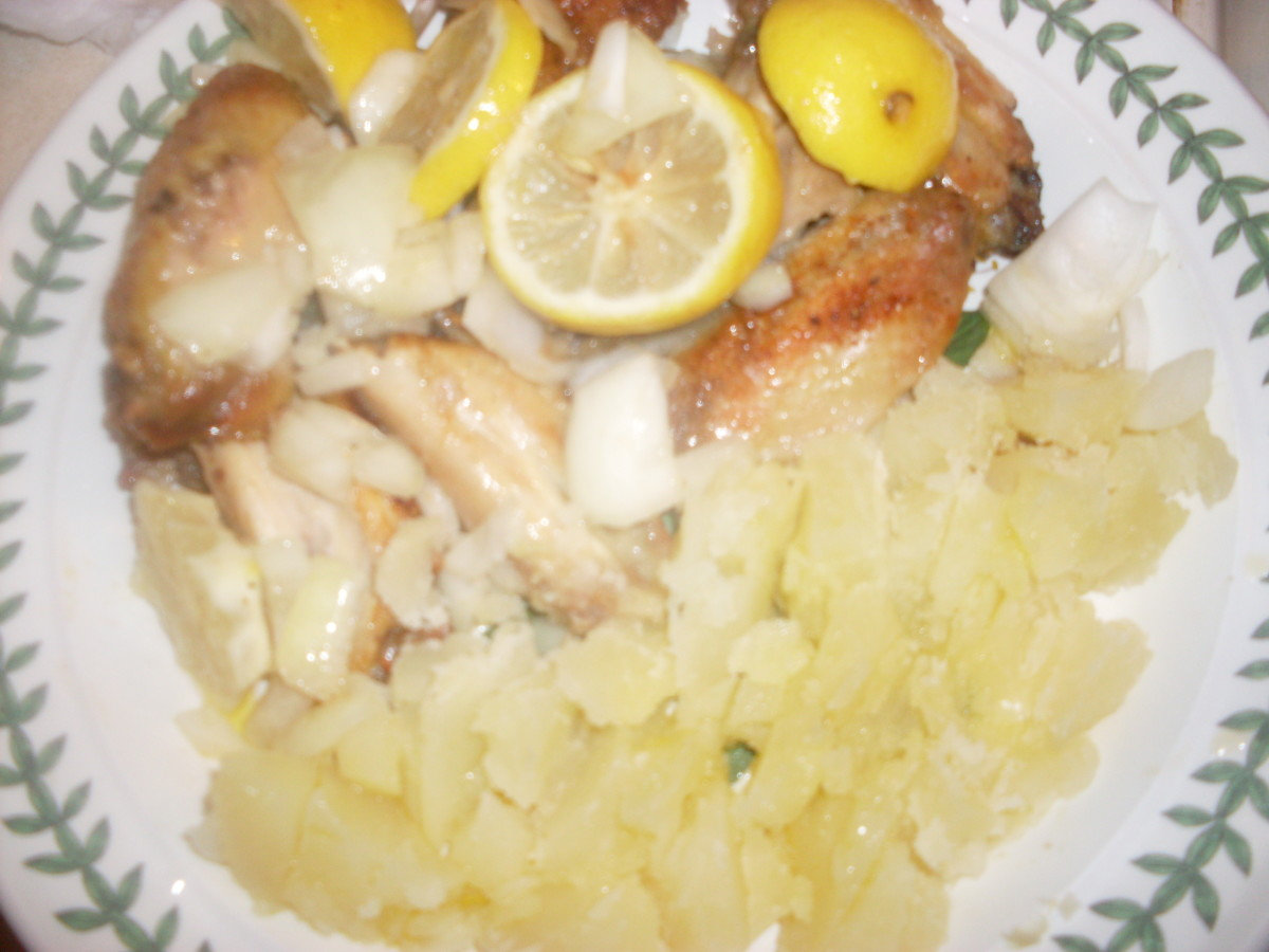 Truly delicious chicken wings with lemon, onion and potatoes