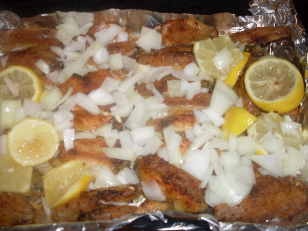 tasty and fresh pieces of onion and lemon slices on the chicken wings