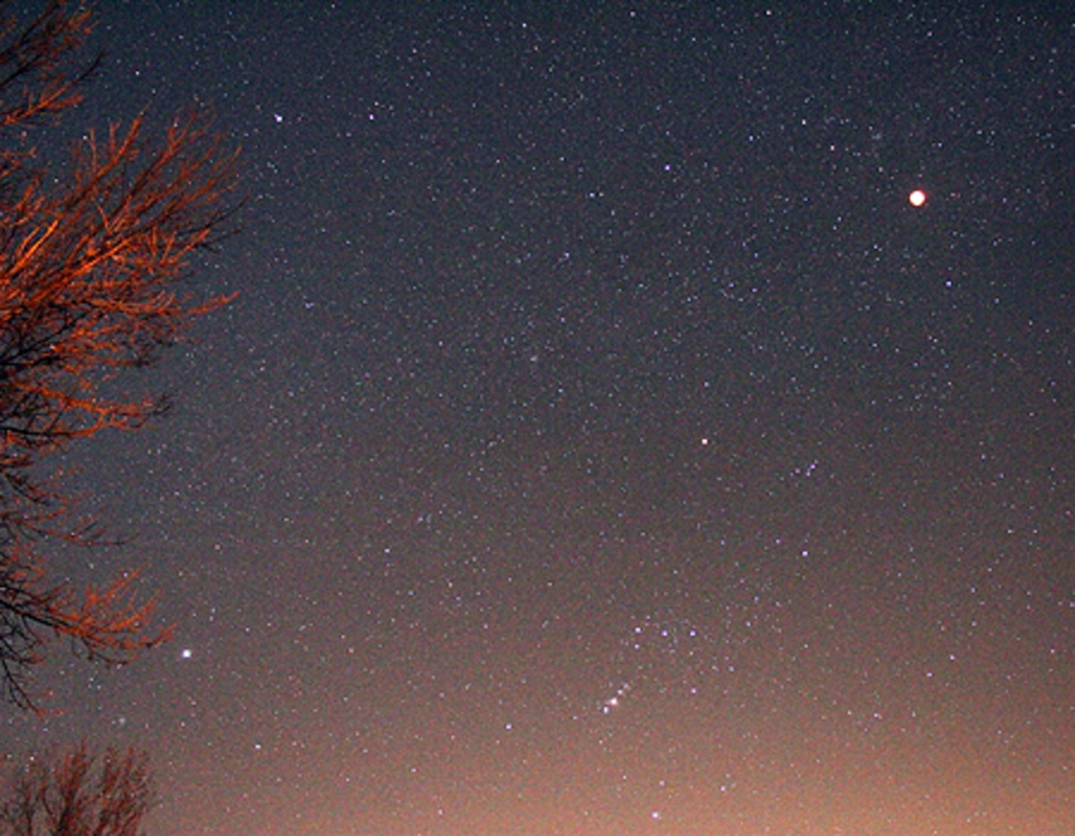 This time lapse photo clearly shows the 2010 winter solstice lunar eclipse in the Heart of Sky. The belt of Orion is clearly seen. The Heart of Sky is lined up directly above from the line extending through the three stars in Orion's sword.