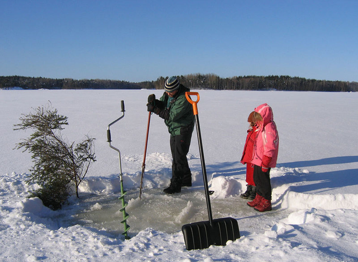 Cutting a hole in the ice when the lake is frozen.