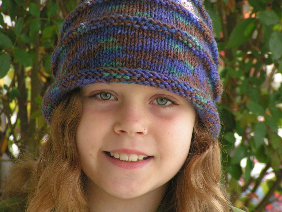 My daughter in the first hat I knitted.