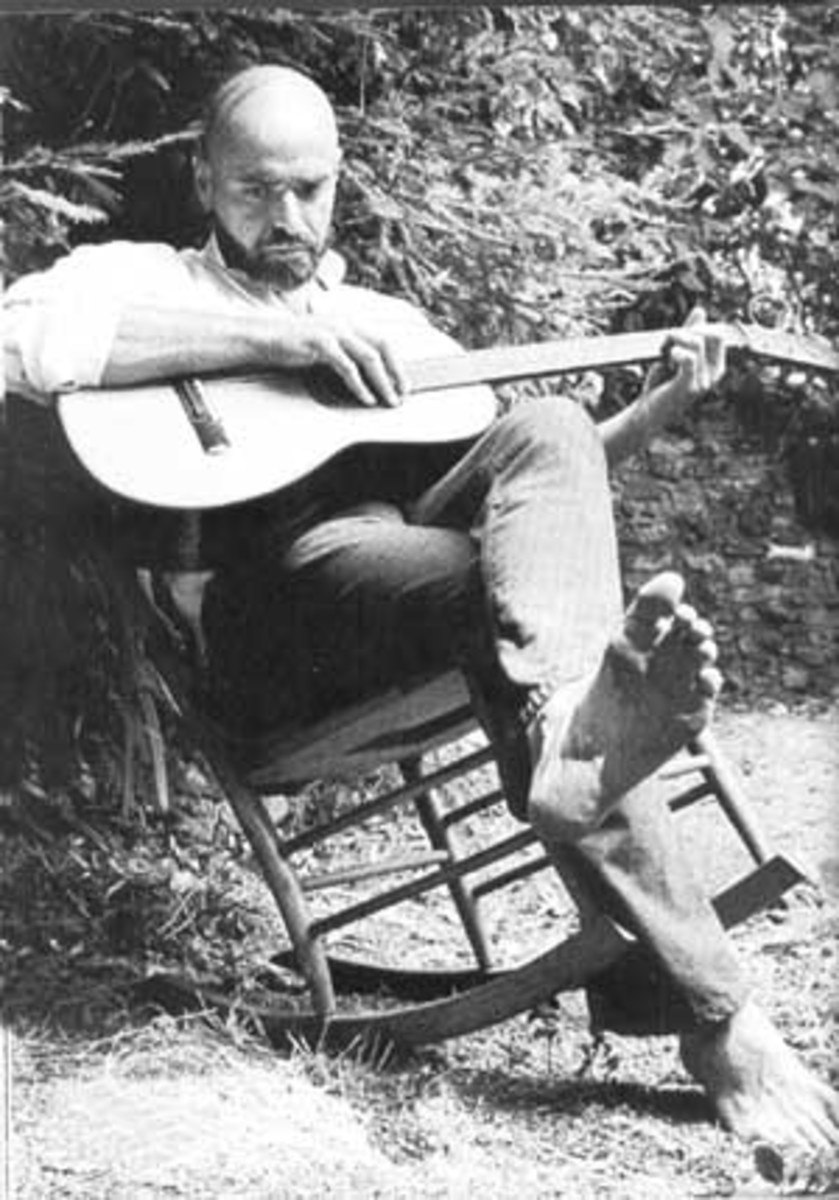 Shel Silverstein strumming his guitar