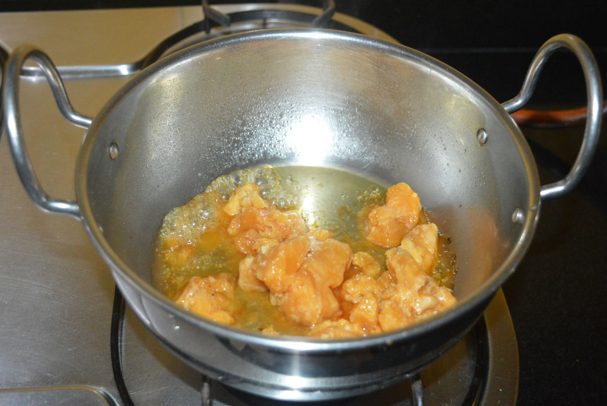 Step three: Add jaggery powder and some water to a deep-bottomed pan. Keep the heat at medium. Keep stirring the mixture.