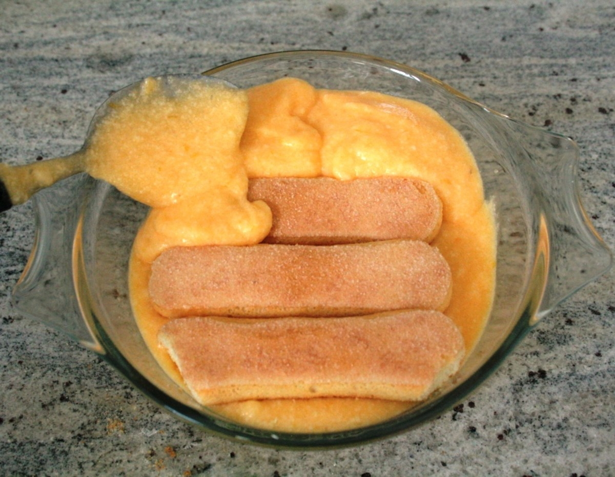 Layer the sponge fingers with the lemon mixture.