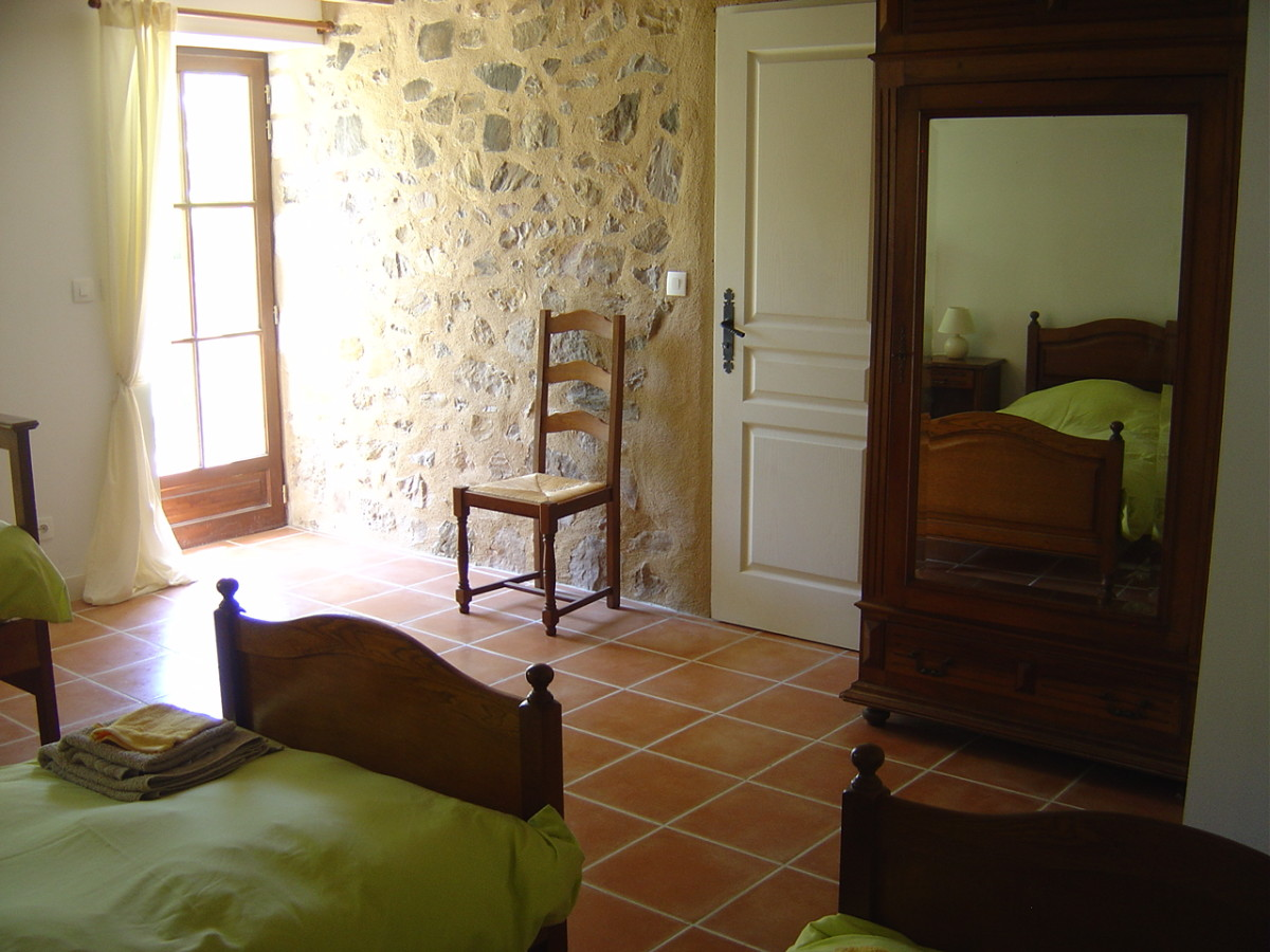 Bedroom 3 has three single beds and opens onto the garden